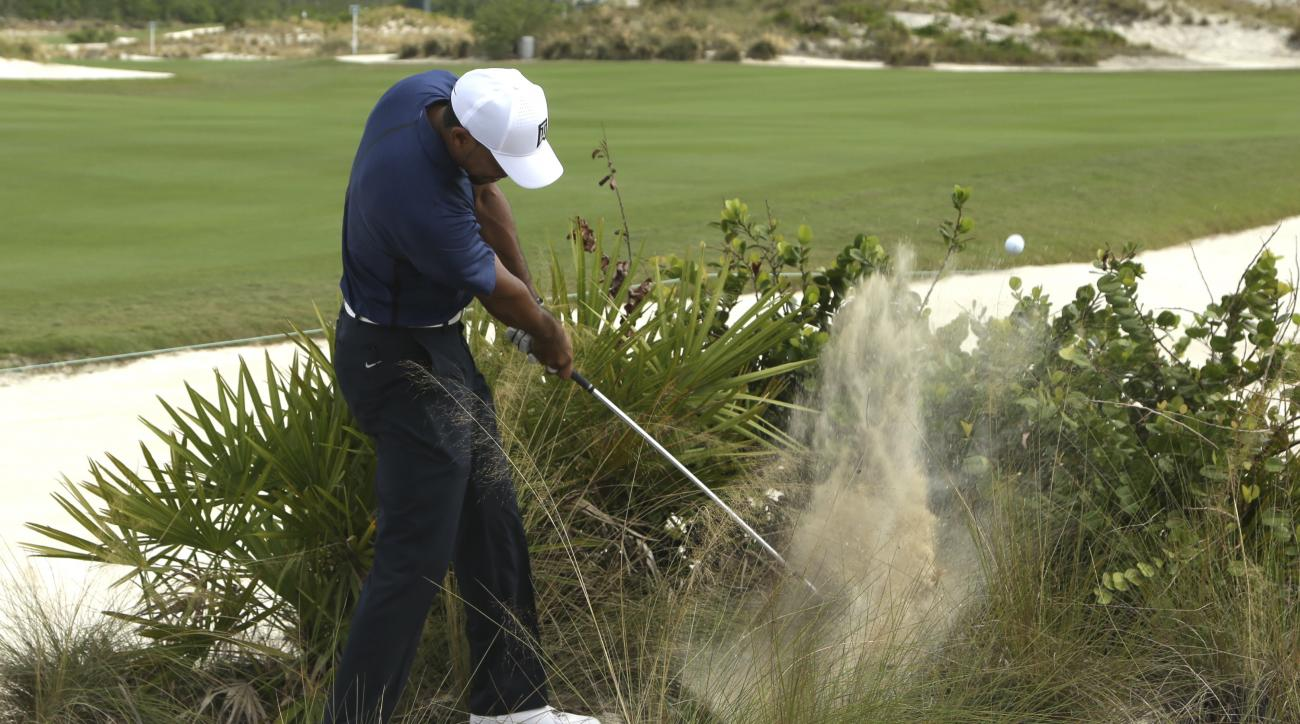 Tiger Woods hits off the 16th fairway during the second round at the Hero World Challenge golf tournament, Friday, Dec. 2, 2016, in Nassau, Bahamas. Woods is six-under-par. (AP Photo/Lynne Sladky)