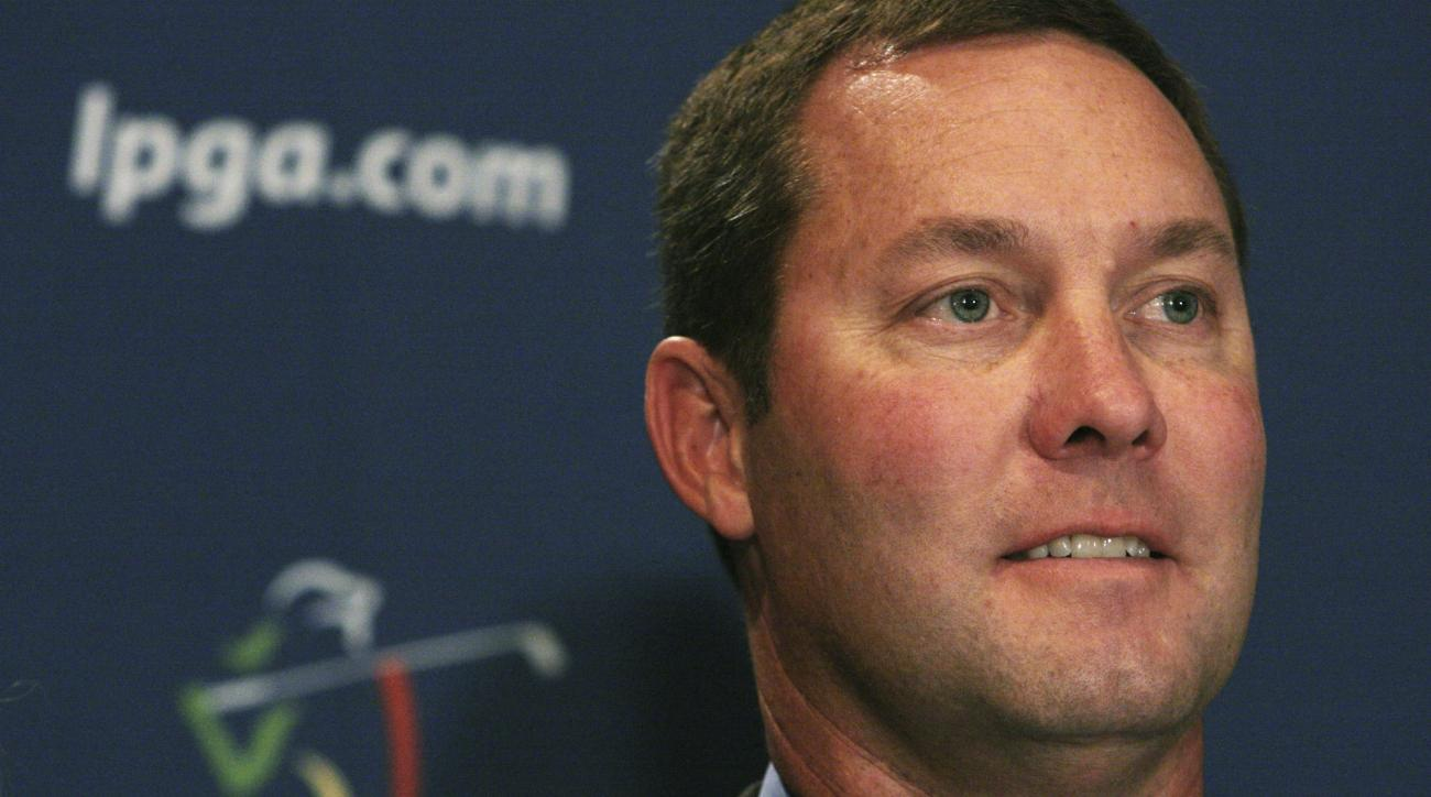Michael Whan poses for photographers during a press conference announcing his appointment as the new Ladies Professional Golf Association (LPGA) Commissioner Wednesday Oct. 28, 2009 in New York. (AP Photo/Tina Fineberg)