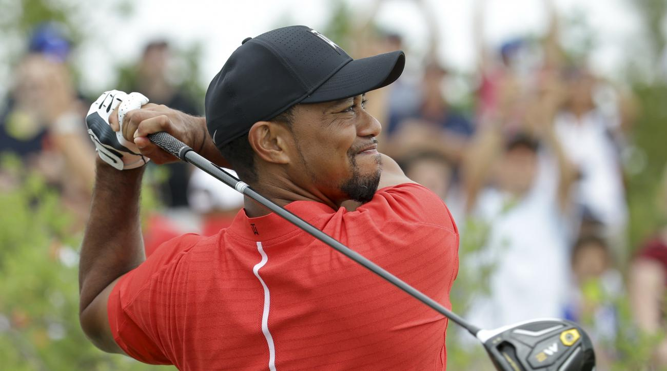 Tiger Woods watches his tee shot on the first hole during the final round at the Hero World Challenge golf tournament, Sunday, Dec. 4, 2016, in Nassau, Bahamas. (AP Photo/Lynne Sladky)