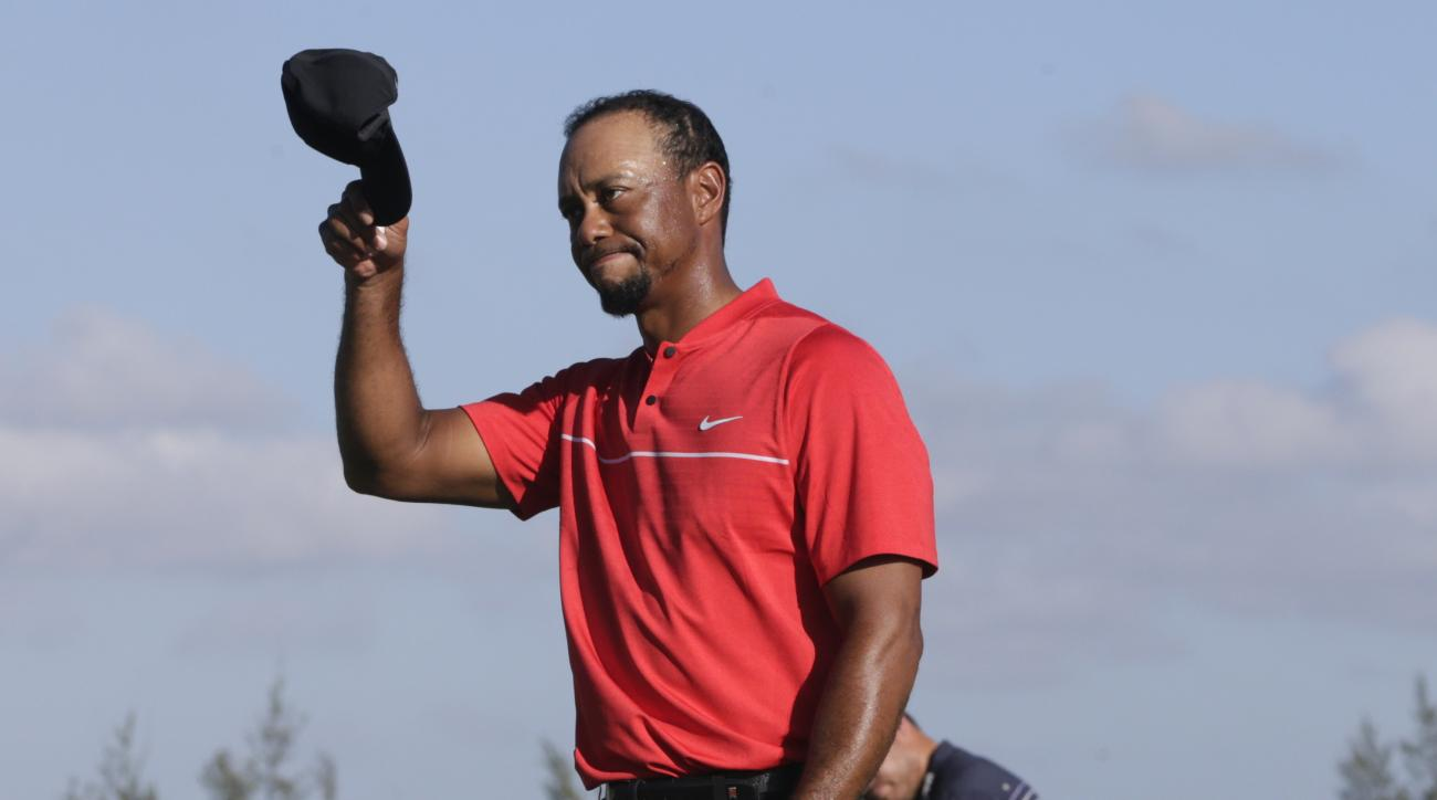 Tiger Woods walks off the 18th green during the final round at the Hero World Challenge golf tournament, Sunday, Dec. 4, 2016, in Nassau, Bahamas. (AP Photo/Lynne Sladky)