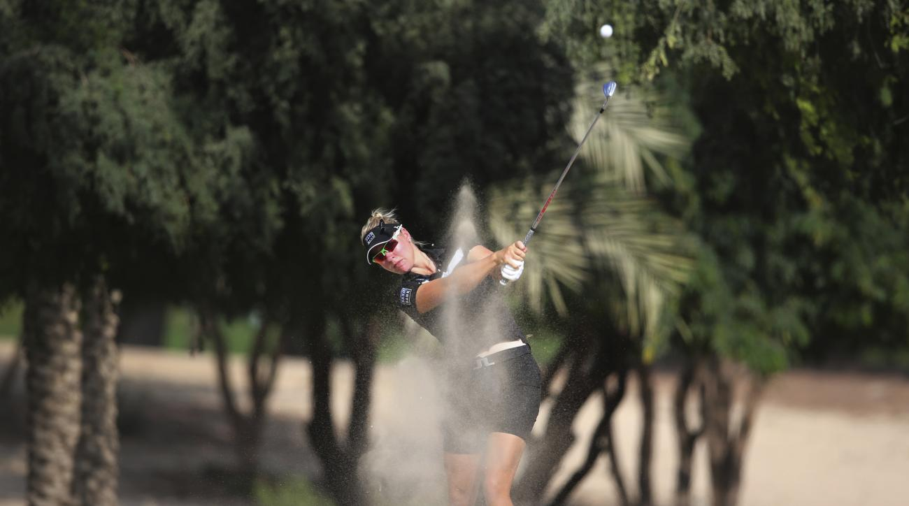 Nicole Broch Larsen of Denmark plays a shot on the 14th hole during the Revised 1st round of Dubai Ladies Masters golf tournament in Dubai, United Arab Emirates, Thursday, Dec. 8, 2016. (AP Photo/Kamran Jebreili)