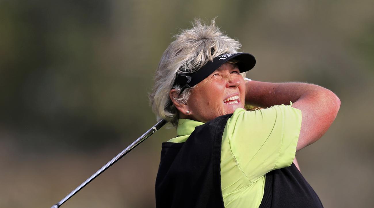 Laura Davies of England tees off on the 15th hole during the revised 1st round of Dubai Ladies Masters golf tournament in Dubai, United Arab Emirates, Thursday, Dec. 8, 2016. (AP Photo/Kamran Jebreili)