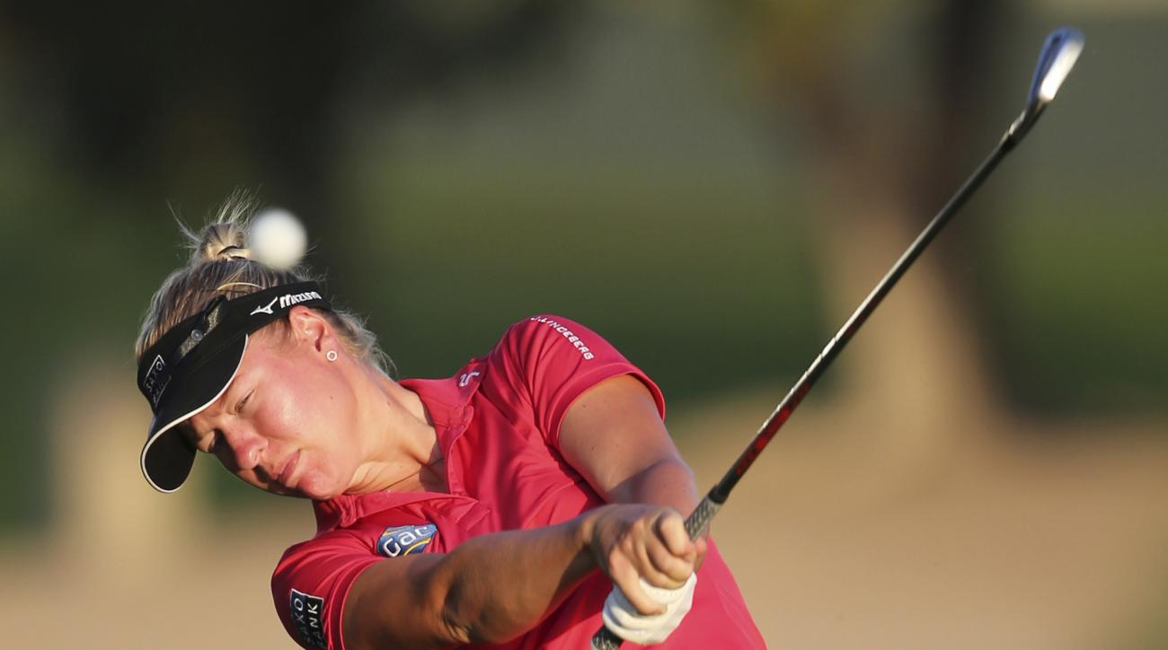 Nicole Broch Larsen of Denmark plays a shot on the 10th hole during the revised 2nd round of Dubai Ladies Masters golf tournament in Dubai, United Arab Emirates, Friday, Dec. 9, 2016. (AP Photo/Kamran Jebreili)