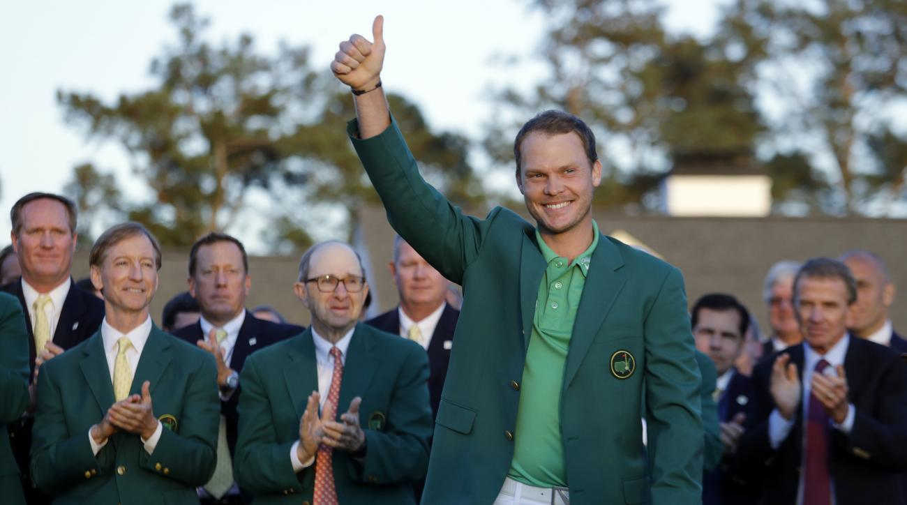 FILE - In this Sunday, April 10, 2016, file photo, Masters champion Danny Willett, of England, gives a thumbs up after winning the Masters golf tournament in Augusta, Ga. (AP Photo/Jae C. Hong, File)
