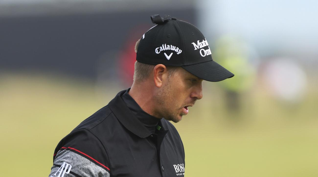 FILE - In this July 17, 2016, file photo, Henrik Stenson of Sweden reacts after making a birdie putt on the 15th green during the final round of the British Open Golf Championship at the Royal Troon Golf Club in Troon, Scotland. It was the most significan