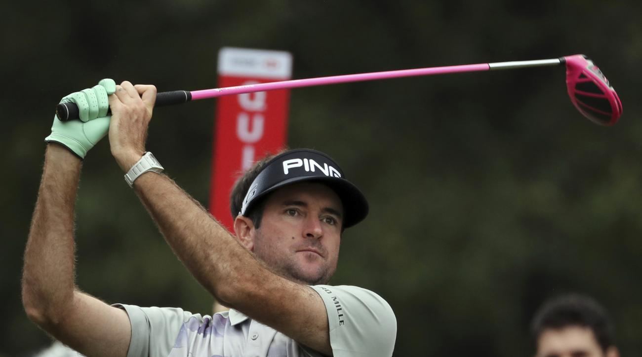 FILE - In this Oct. 27, 2016, file photo, Bubba Watson from the U.S. watches his tee shot on the 10th hole during the WGC-HSBC Champions golf tournament at the Sheshan International Golf Club in Shanghai, China. A South Korea newspaper is reporting that W