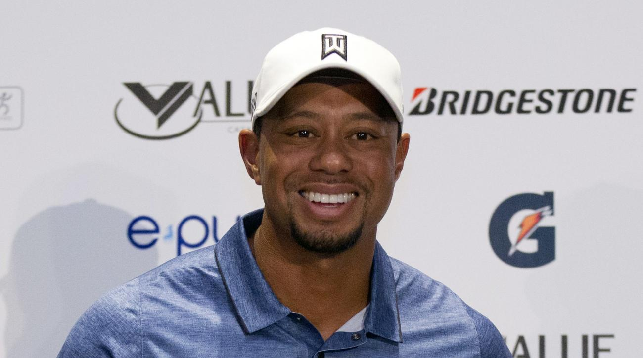 FILE - In this Oct. 20, 2015, file photo, Tiger Woods arrives for a press conference to launch Bridgestone America's Golf Cup in Mexico City. One tournament into his return was all Tiger Woods needed to strike a deal with Bridgestone to play its golf ball