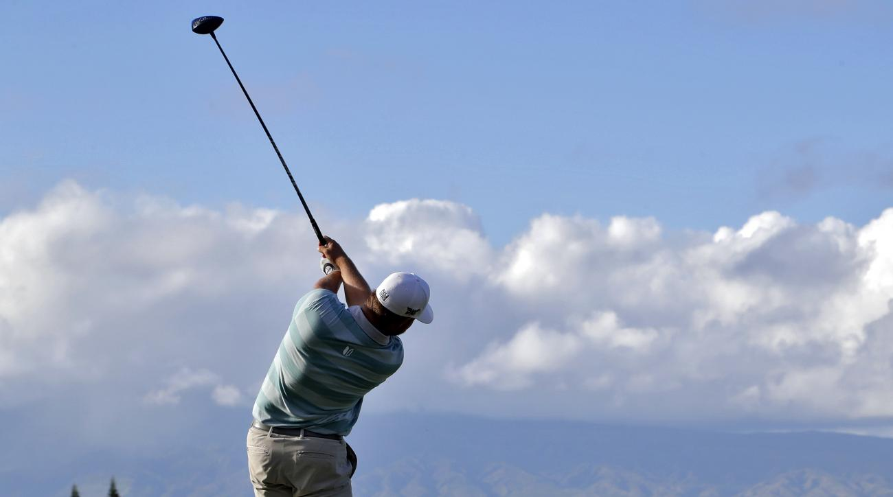 Ryan Moore hits from the 18th tee during the first round of the Tournament of Champions golf event, Thursday, Jan. 5, 2017, at Kapalua Plantation Course in Kapalua, Hawaii. (AP Photo/Matt York)