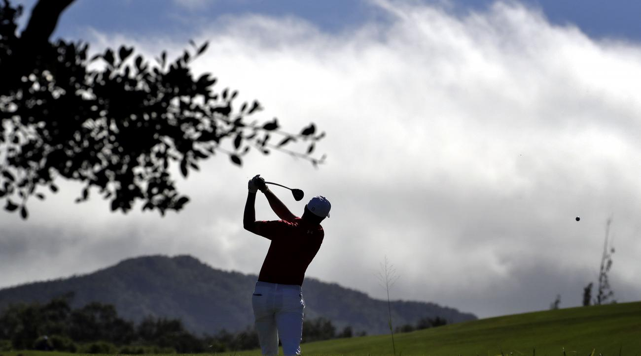 Jordan Spieth hits from the fourth tee during the second round of the Tournament of Champions golf event, Friday, Jan. 6, 2017, at Kapalua Plantation Course in Kapalua, Hawaii. (AP Photo/Matt York)