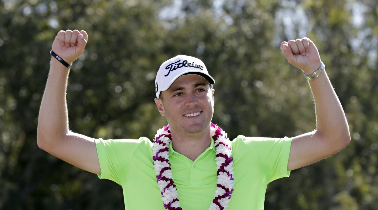 Justin Thomas celebrates after the final round of the Tournament of Champions golf event, Sunday, Jan. 8, 2017, at Kapalua Plantation Course in Kapalua, Hawaii. (AP Photo/Matt York)