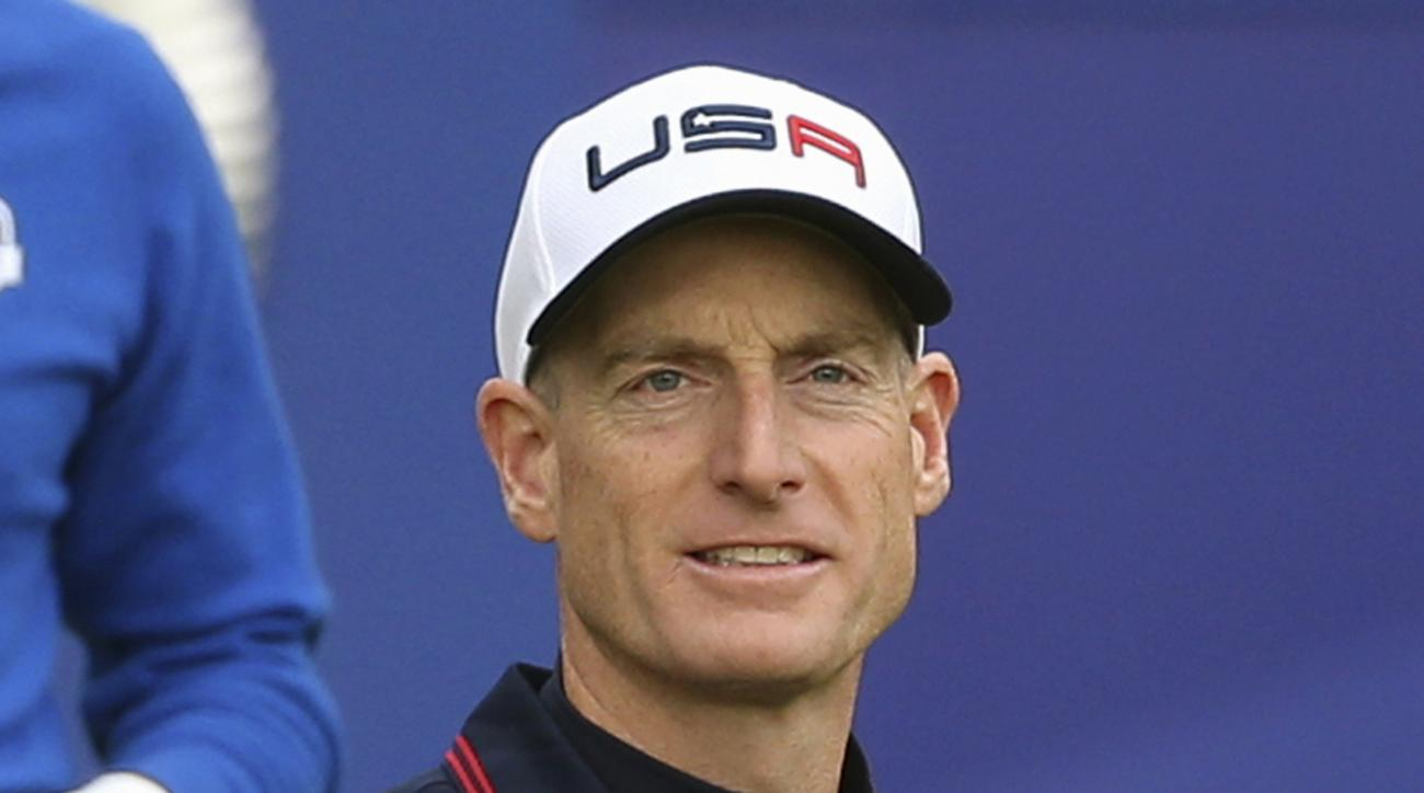 FILE - In this Sept. 28, 2014, file photo, Jim Furyk, of the United States, walks off the tee box after playing the first hole during a singles match on the final day of the Ryder Cup golf tournament, at Gleneagles, Scotland. Furyk has been appointed U.S.