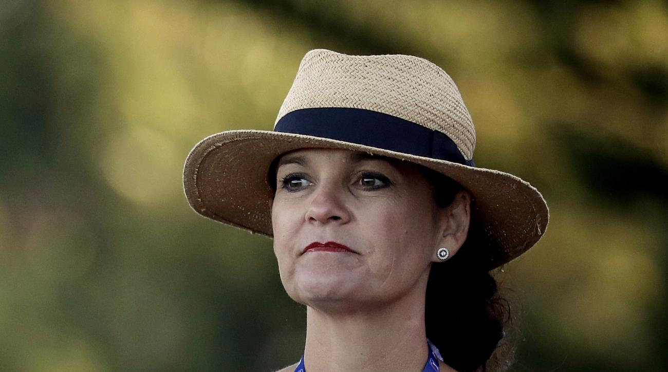 Angela Pampling watches her husband, Rod Pampling, of Australia, hit from the first tee during the final round of the Tournament of Champions golf event, Sunday, Jan. 8, 2017, at Kapalua Plantation Course in Kapalua, Hawaii. Rod Pampling met his wife, a c