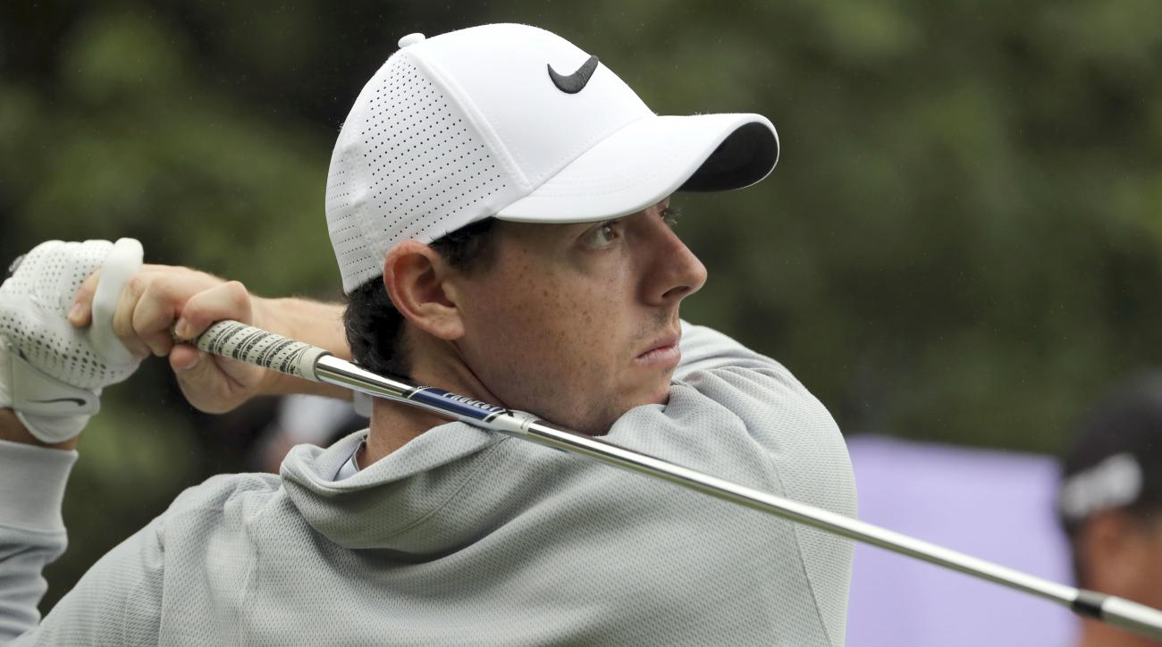 FILE - In this Thursday, Oct. 27, 2016 file photo, Rory McIlroy of Northern Ireland hits a tee shot during the WGC-HSBC Champions golf tournament at the Sheshan International Golf Club in Shanghai, China. Rory McIlroy turned in a third-round 67, to play a