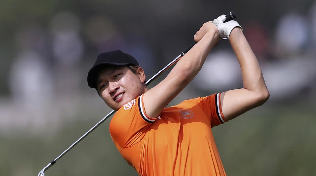 Jeunghun Wang of Korea plays a shot on the 2nd hole during the final round of Abu Dhabi Golf Championship in Abu Dhabi, United Arab Emirates, Sunday, Jan. 22, 2017. (AP Photo/Kamran Jebreili)