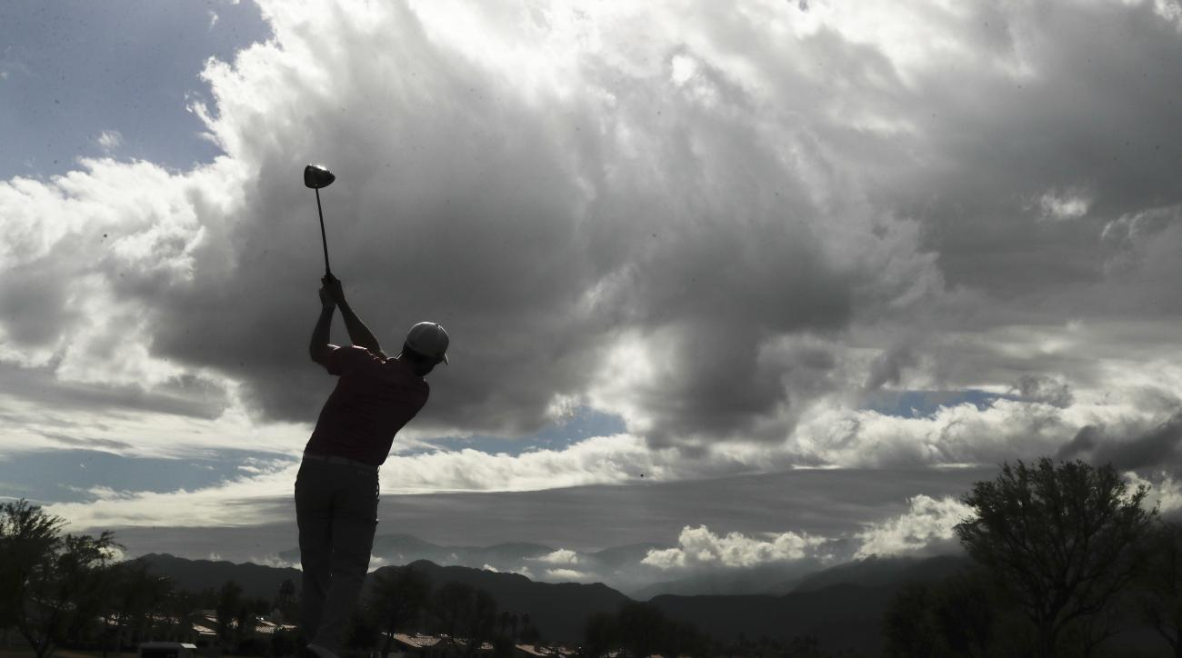 Adam Hadwin watches his tee shot on the eighth hole during the final round of the CareerBuilder Challenge golf tournament on the Stadium Course at PGA West, Sunday, Jan. 22, 2017, in La Quinta, Calif. (AP Photo/Chris Carlson)