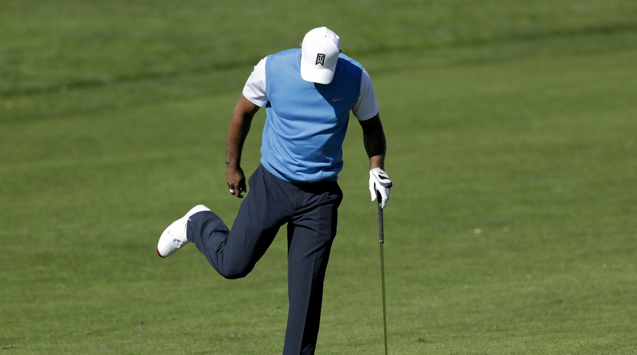 Tiger Woods reacts after his second shot on the fifth hole of the south course during the first round of the Farmers Insurance Open golf tournament Thursday, Jan. 26, 2017, in San Diego. (AP Photo/Gregory Bull)