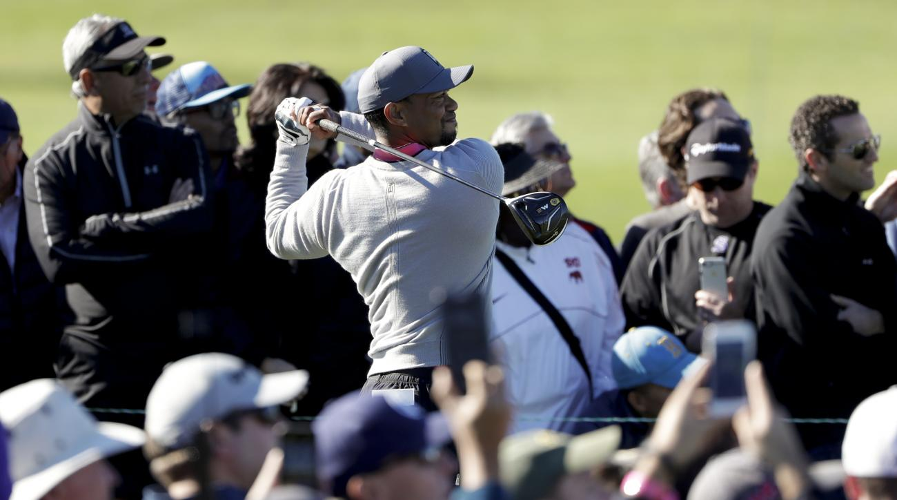 Tiger Woods watches his tee shot on the 13th hole of the north course during the second round of the Farmers Insurance Open golf tournament Friday, Jan. 27, 2017, at Torrey Pines Golf Course in San Diego. (AP Photo/Gregory Bull)