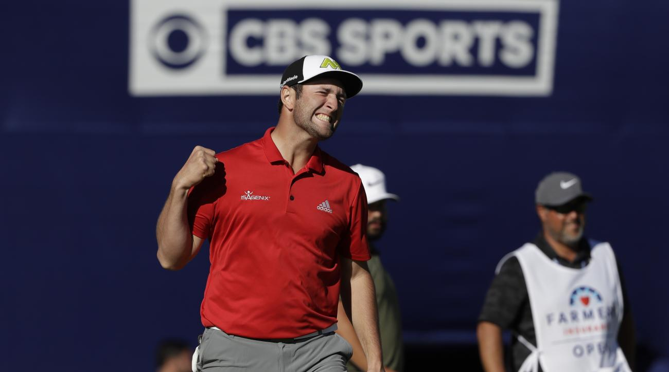 Jon Rahm, of Spain, reacts after making a putt for eagle on the 18th hole of the South Course during the final round of the Farmers Insurance Open golf tournament Sunday, Jan. 29, 2017, at Torrey Pines Golf Course in San Diego. (AP Photo/Gregory Bull)
