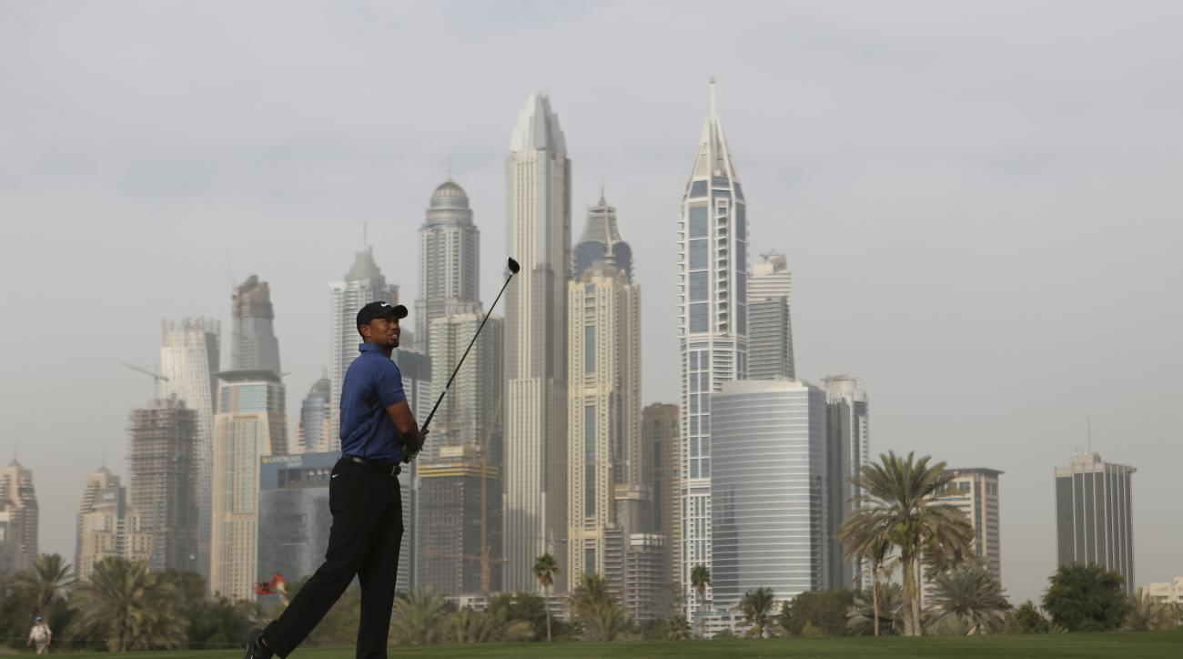 Tiger Woods follows his ball on the 13th hole during the 1st round of the Dubai Desert Classic golf tournament in Dubai, United Arab Emirates, Thursday, Feb. 2, 2017. (AP Photo/Kamran Jebreili)