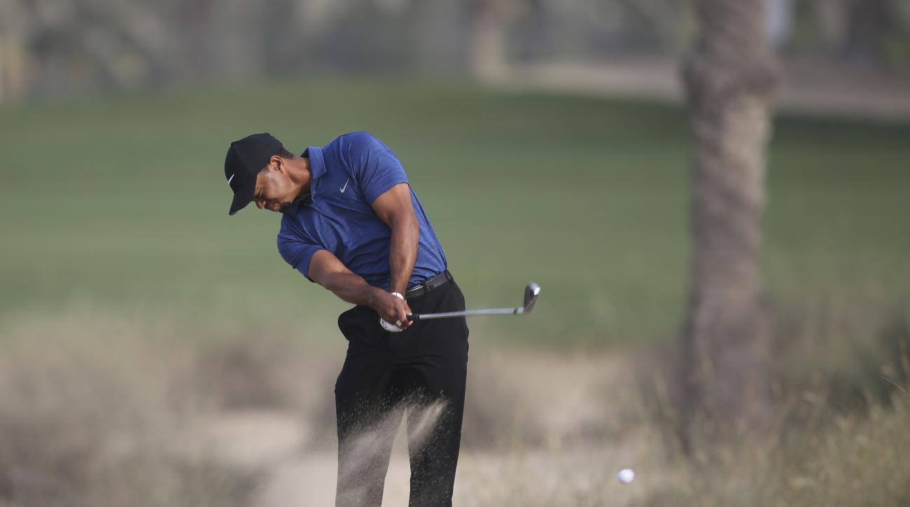 Tiger Woods plays a shot on the 10th hole during the 1st round of the Dubai Desert Classic golf tournament in Dubai, United Arab Emirates, Thursday, Feb. 2, 2017. (AP Photo/Kamran Jebreili)