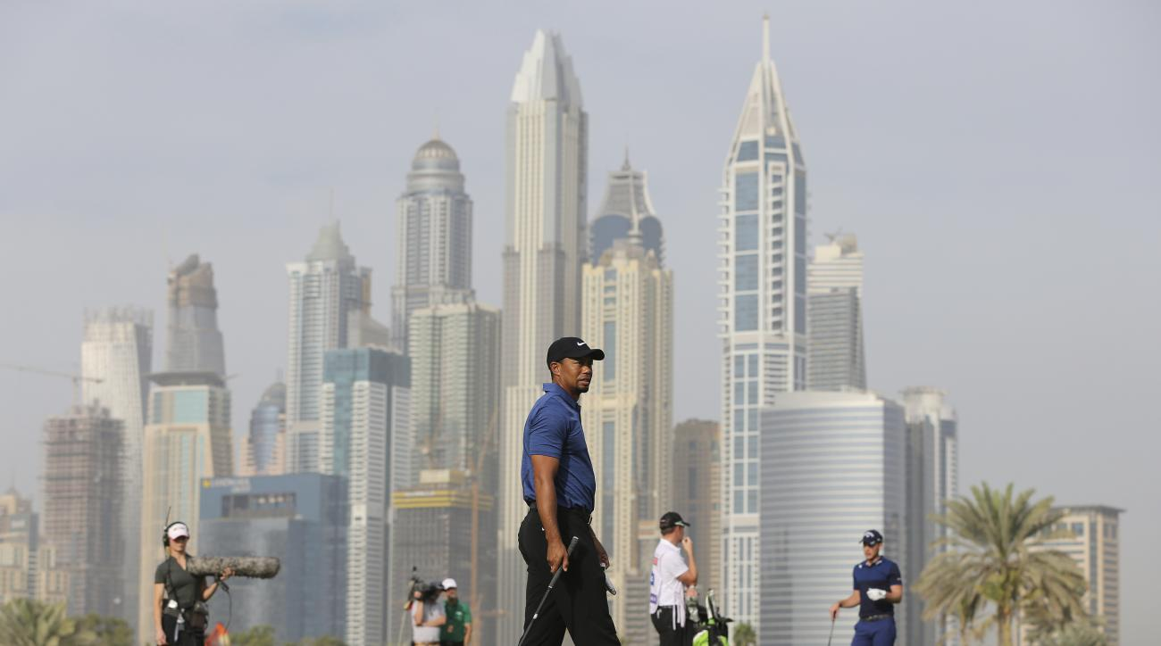 Tiger Woods plays on the 13th hole during the 1st round of the Dubai Desert Classic golf tournament, in Dubai, United Arab Emirates, Thursday, Feb. 2, 2017. (AP Photo/Kamran Jebreili)
