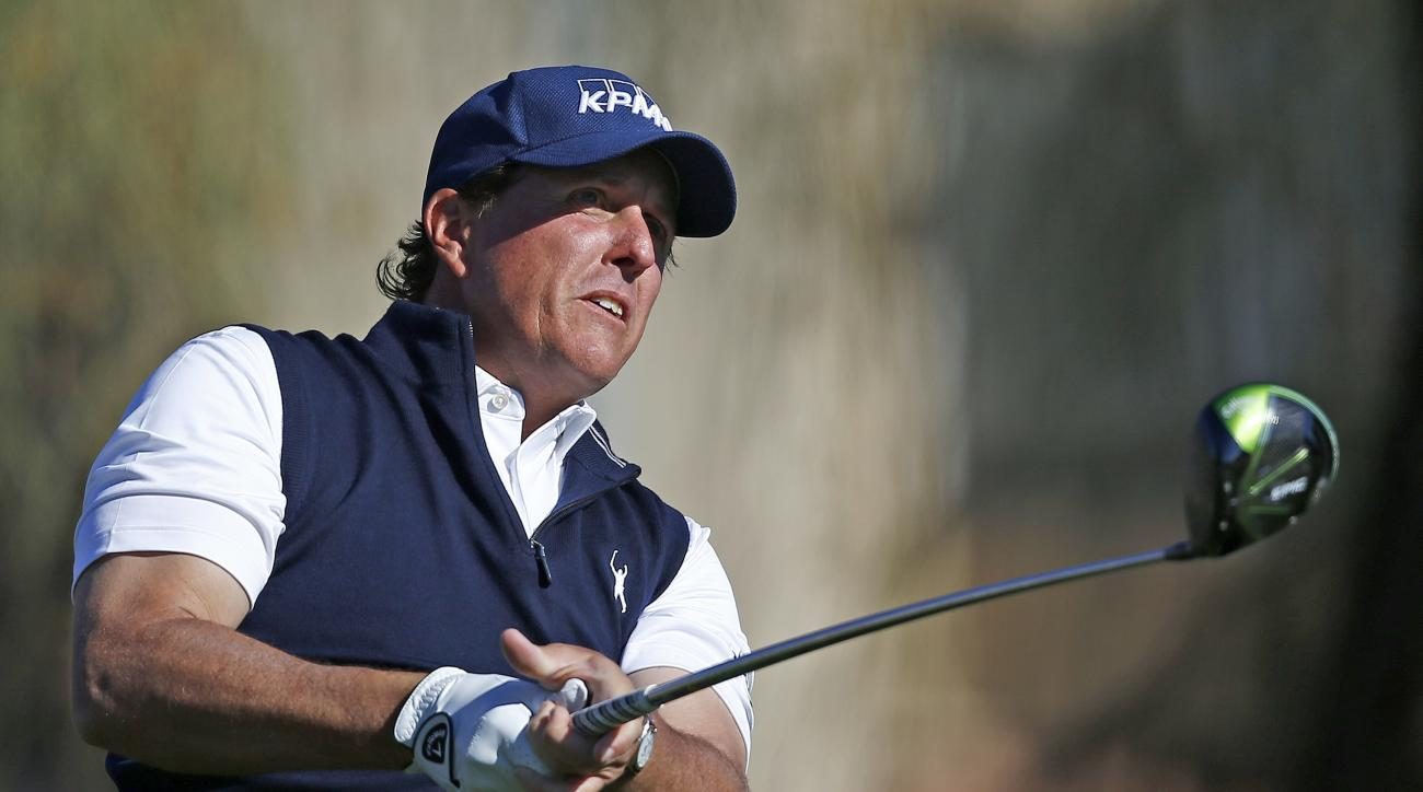Phil Mickelson watches his tee shot at the second hole during the final round of the Waste Management Phoenix Open golf tournament Sunday, Feb. 5, 2017, in Scottsdale, Ariz. (AP Photo/Ross D. Franklin)