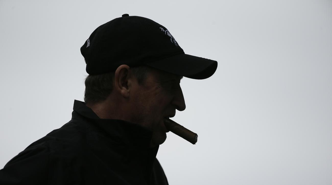 Wayne Gretzky smokes a cigar while waiting to hit from the fourth tee of the Monterey Peninsula Country Club Shore Course during the first round of the AT&T Pebble Beach National Pro-Am golf tournament Thursday, Feb. 9, 2017, in Pebble Beach, Calif. (AP P