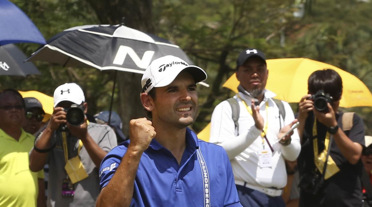 Fabrizio Zanotti of Paraguay reacts after completing the 18th hole during the final day of the Maybank Championship golf tournament in Kuala Lumpur, Malaysia on Sunday, Feb. 12, 2017. (AP Photo/Peter Lim)