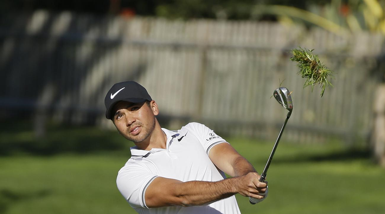 Jason Day, of Australia, follows his chip shot up to the second green of the Pebble Beach Golf Links during the final round of the AT&T Pebble Beach National Pro-Am golf tournament, Sunday, Feb. 12, 2017, in Pebble Beach, Calif. (AP Photo/Eric Risberg)