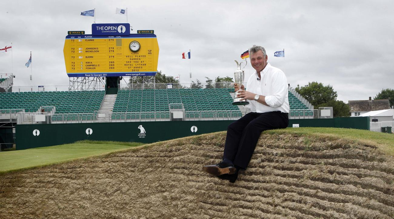 Northern Ireland's Darren Clarke holds the Claret Jug troffy beside the 18th green after he won the Open Golf Championship on Sunday, at Royal St George's Sandwich, England, Monday, July, 18, 2011. (AP Photo/Peter Morrison)