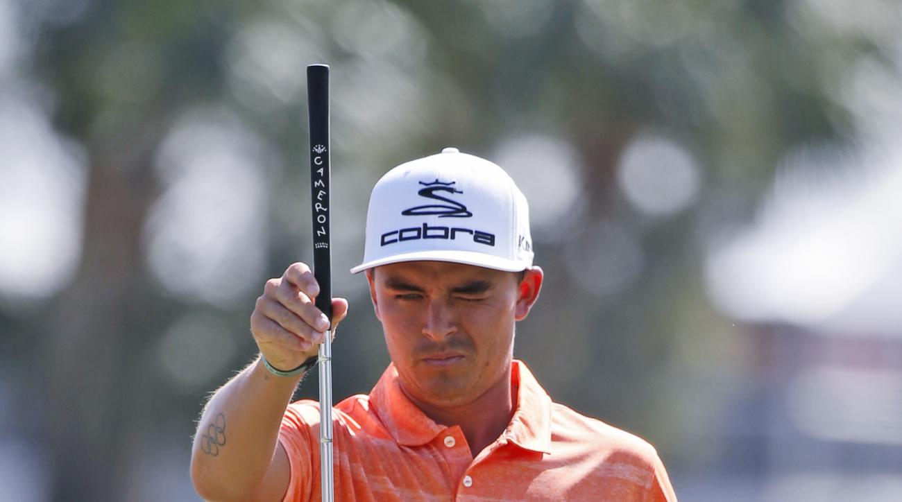 Rickie Fowler lines up a putt on the first hole during the final round of the Honda Classic golf tournament, Sunday, Feb. 26, 2017, in Palm Beach Gardens, Fla. (AP Photo/Wilfredo Lee)