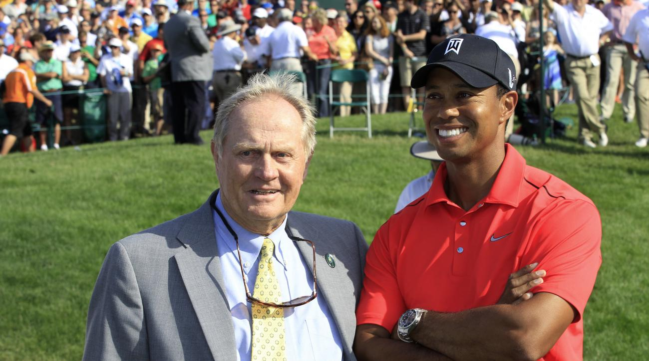 "File-This June 3, 2012, file photo shows Jack Nicklaus, left, and Tiger Woods talking after Woods won the Memorial golf tournament at the Muirfield Village Golf Club in Dublin, Ohio.  Nicklaus says he was ""painting a picture"" when he suggested after a pra"