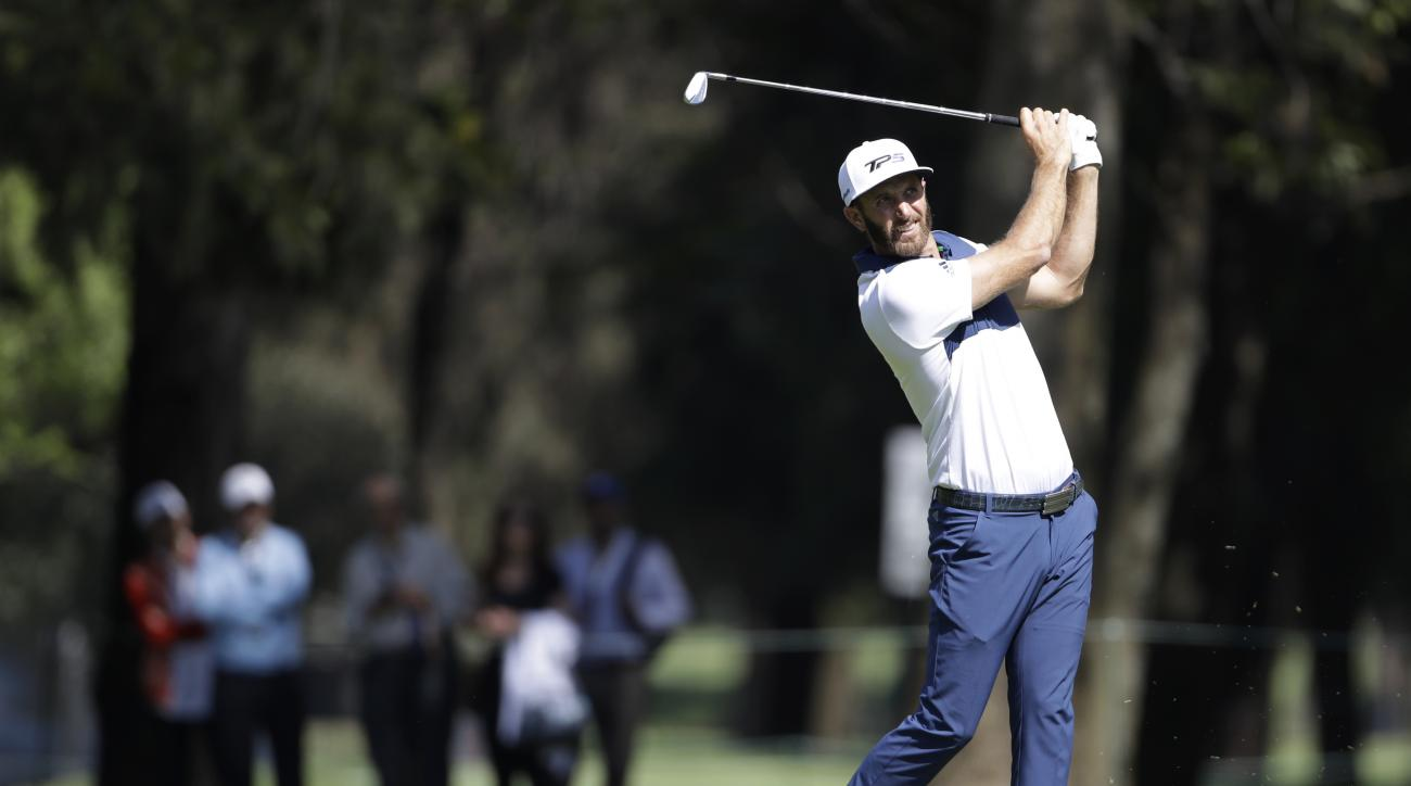 Dustin Johnson of the U.S. drives a ball on the eighth hole as golfers practice on the high-altitude course at Chapultepec Golf Club a day before the start of the Mexico Championship, in Mexico City, Wednesday, March 1, 2017. All but one of the world's to