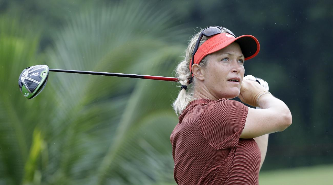 Suzann Pettersen of Norway watches her shot after teeing off on the 6th hole during the HSBC Women's Champions golf tournament held at Sentosa Golf Club's Tanjong course on Saturday, March 4, 2017, in Singapore. (AP Photo/Wong Maye-E)