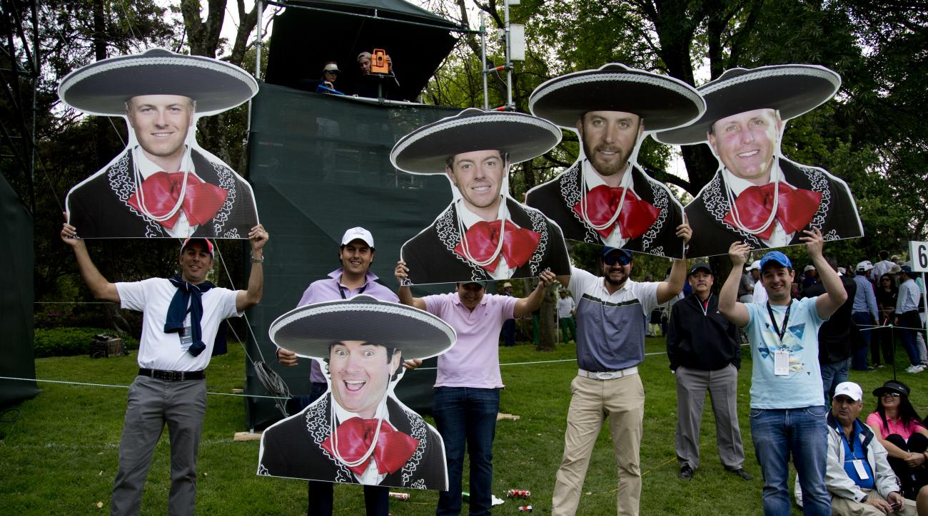 Mexican golf fans hold mariachi motif cutouts depicting from left to right; Jordan Spieth, of the U.S.; Bubba Watson, of the U.S.; Northern Irelands Rory McIlroy; Dustin Johnson and Phil Mickelson both of the U.S., during round three of the Mexico Champio