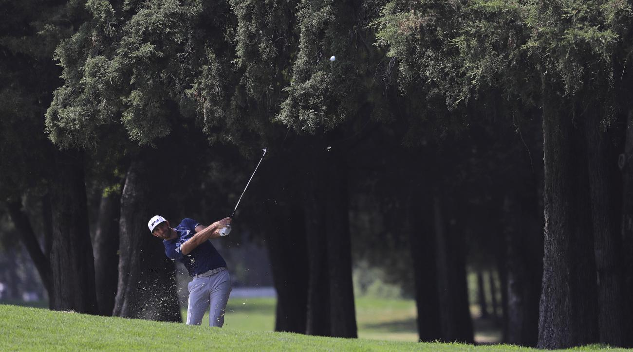 Dustin Johnson, of the United States, hits the ball at the 4th hole during the final round of the Mexico Championship at Chapultepec Golf Club in Mexico City, Sunday, March 5, 2017. All but one of the world's top 50 golfers are contesting the World Golf C