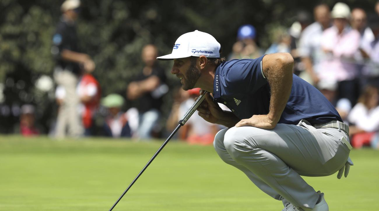 Dustin Johnson, of the United States, squats down at the 5th hole during the final round of the Mexico Championship at Chapultepec Golf Club in Mexico City, Sunday, March 5, 2017. All but one of the world's top 50 golfers are contesting the World Golf Cha