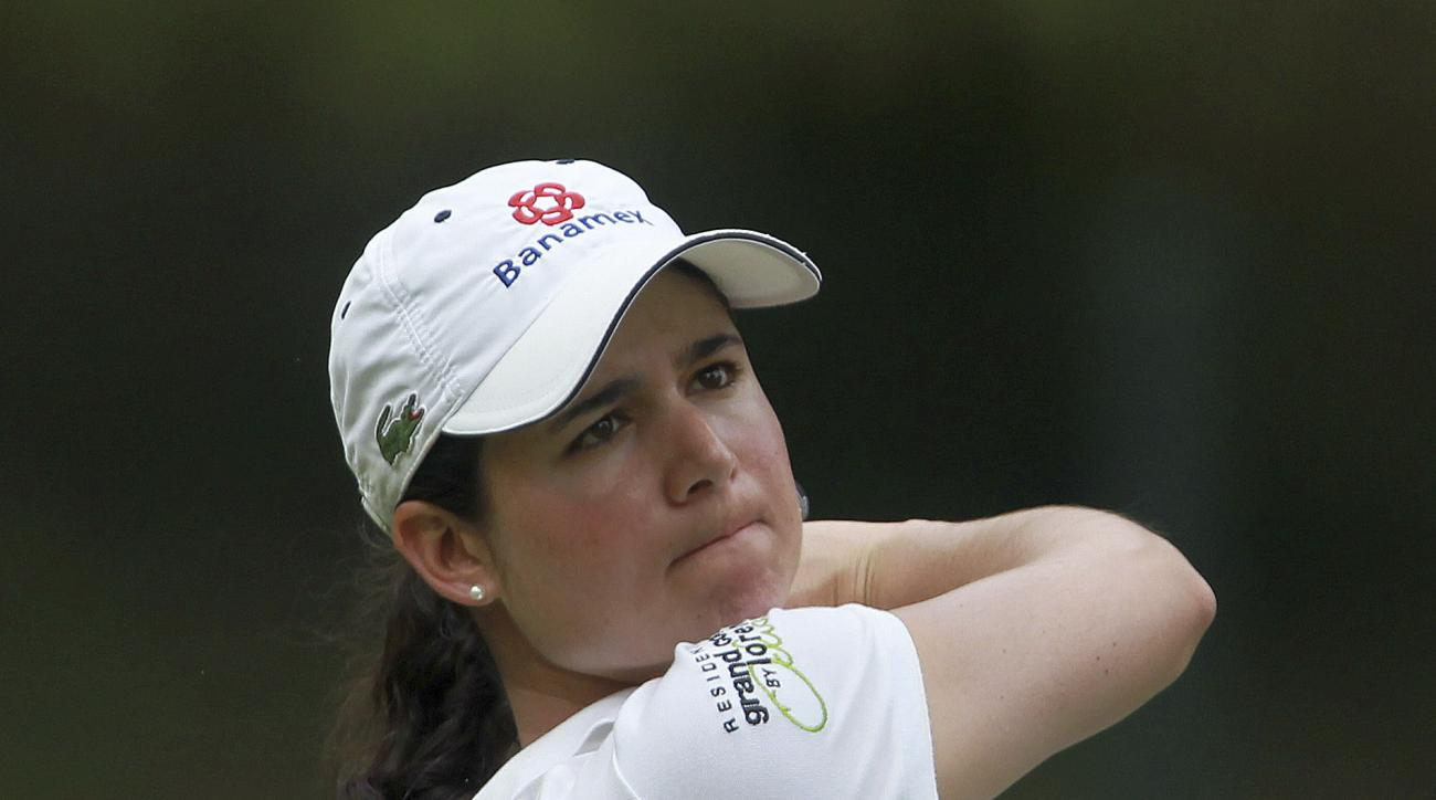 Lorena Ochoa of Mexico plays a tee shot during the third round of the women's Lacoste Open in Saint Jean de Luz, southwestern France, Saturday, Oct. 6, 2012. (AP Photo/Bob Edme)