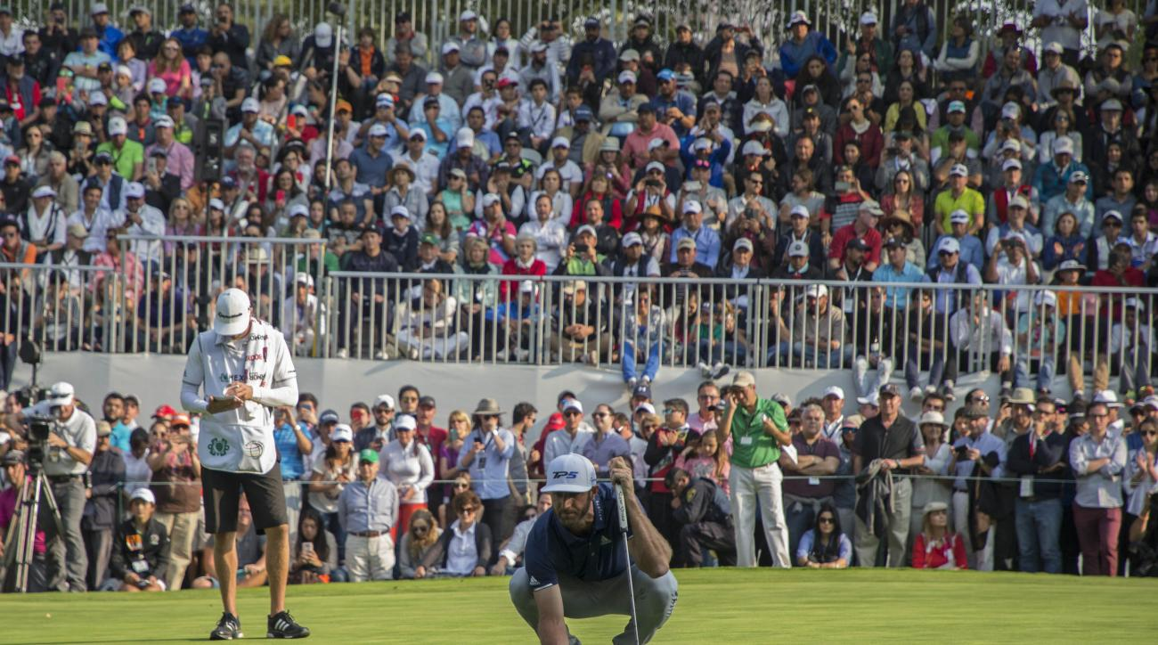 Dustin Johnson, of the United States, puts the ball on the green of the 18th hole during the final round of the Mexico Championship at Chapultepec Golf Club in Mexico City, Sunday, March 5, 2017. Johnson won the Mexico Championship in his debut as the No.