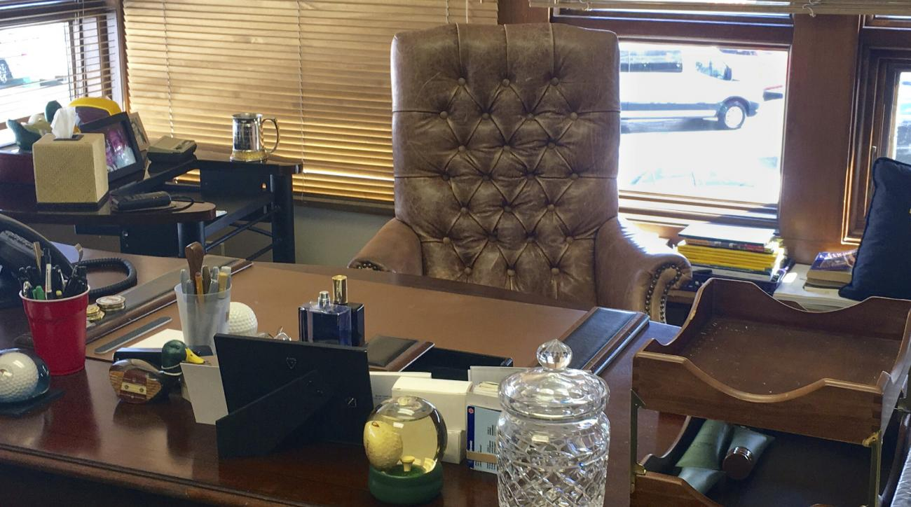 Arnold Palmer's desk is shown at Bay Hill Club & Lodge in Orlando, Fla., Wednesday, March 8, 2017. A bottle of Musk Monsieur is still on his desk, the cologne that always announced Arnold Palmer was near. Next to it is plastic cups that hold pens he used