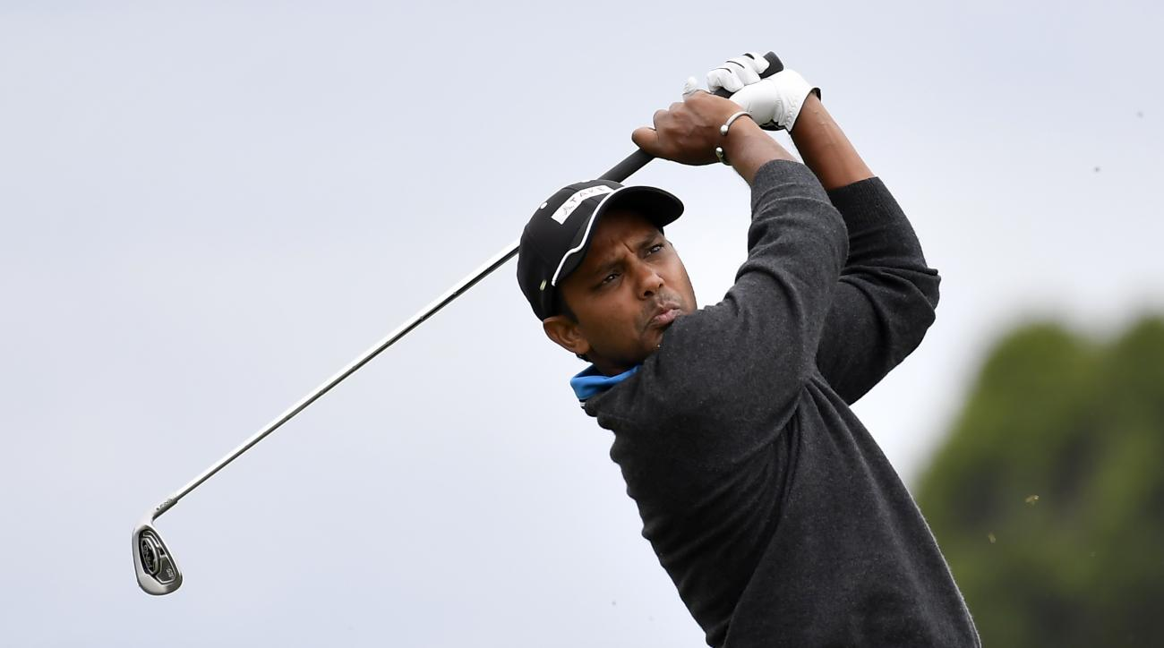 India's Shiv Chawrasia watches his shot on the first hole during his match at the World Cup of Golf at Kingston Heath in Melbourne, Australia, Saturday, Nov. 26, 2016. (AP Photo/Andrew Brownbill)