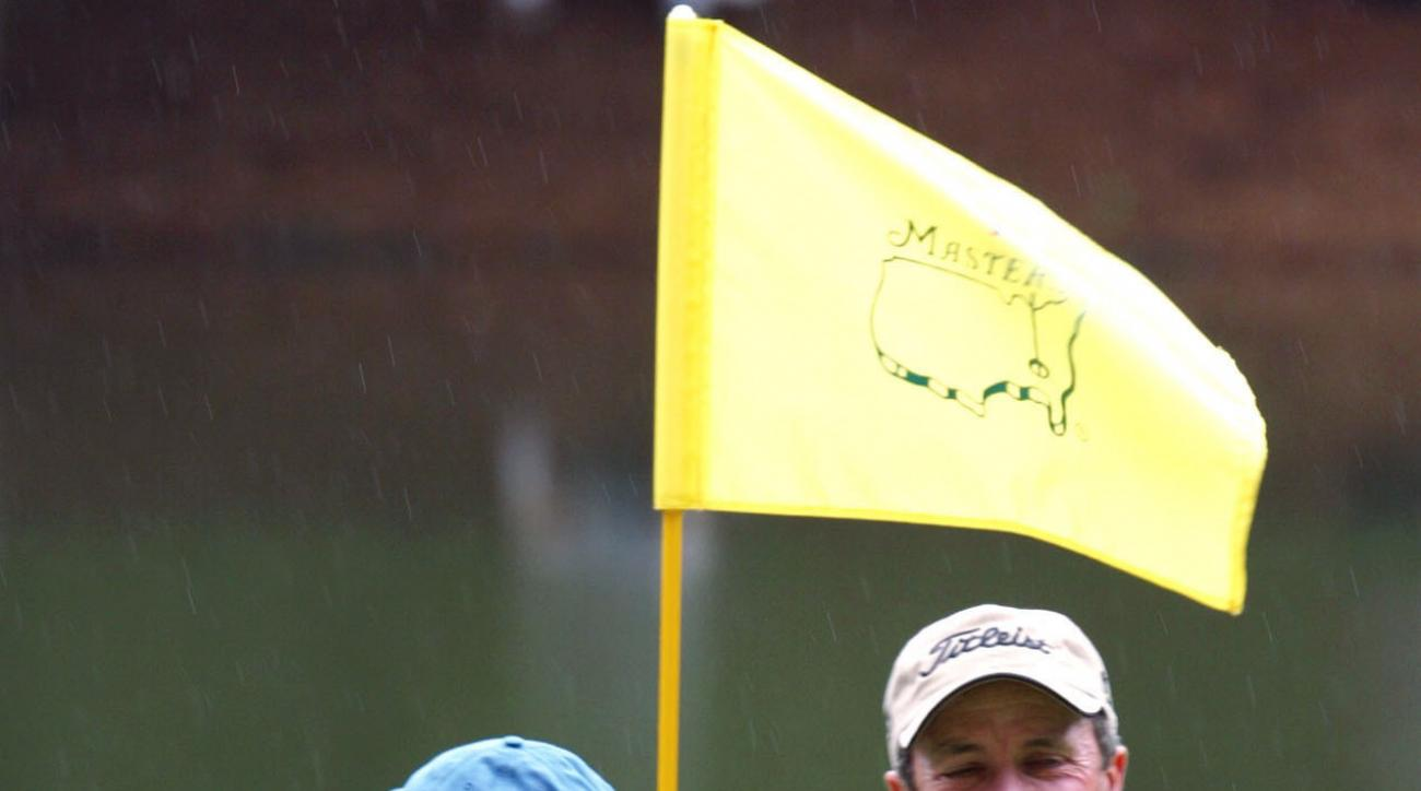FILE - In this April 10, 2003, file photo, Jerry Pate, right, is all smiles as he is greeted by Ben Crenshaw, left, at the ninth green after sinking the ball for par on a penalty shot from the tee box in the Masters' Par 3 Contest at the Augusta National