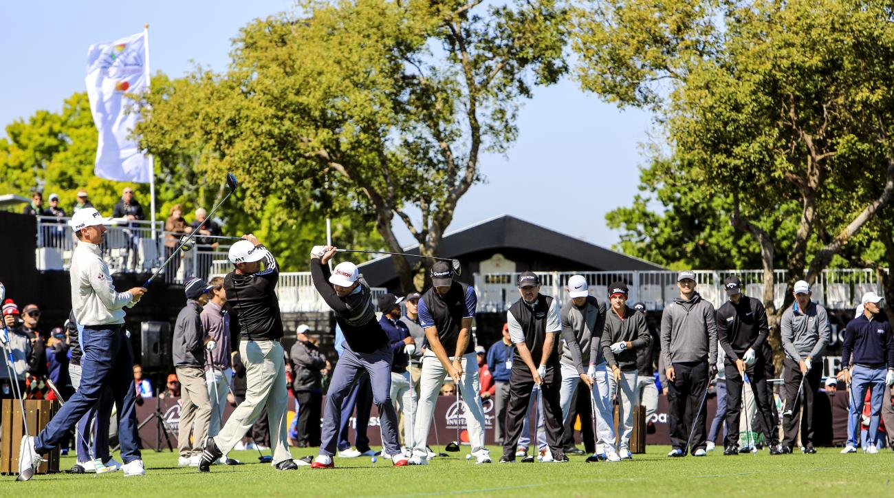 Professional golfers line up and tee off for a ceremonial tee shot on Wednesday morning, March 15, 2017,  at the Arnold Palmer Invitational golf tournament in Orlando, Fla. They hit the ball one after the other to honor the memory of the late golfer great