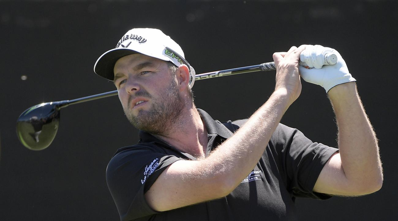 Marc Leishman, of Australia, watches his tee shot on the first hole during the final round of the Arnold Palmer Invitational golf tournament in Orlando, Fla., Sunday, March 19, 2017. (AP Photo/Phelan M. Ebenhack)