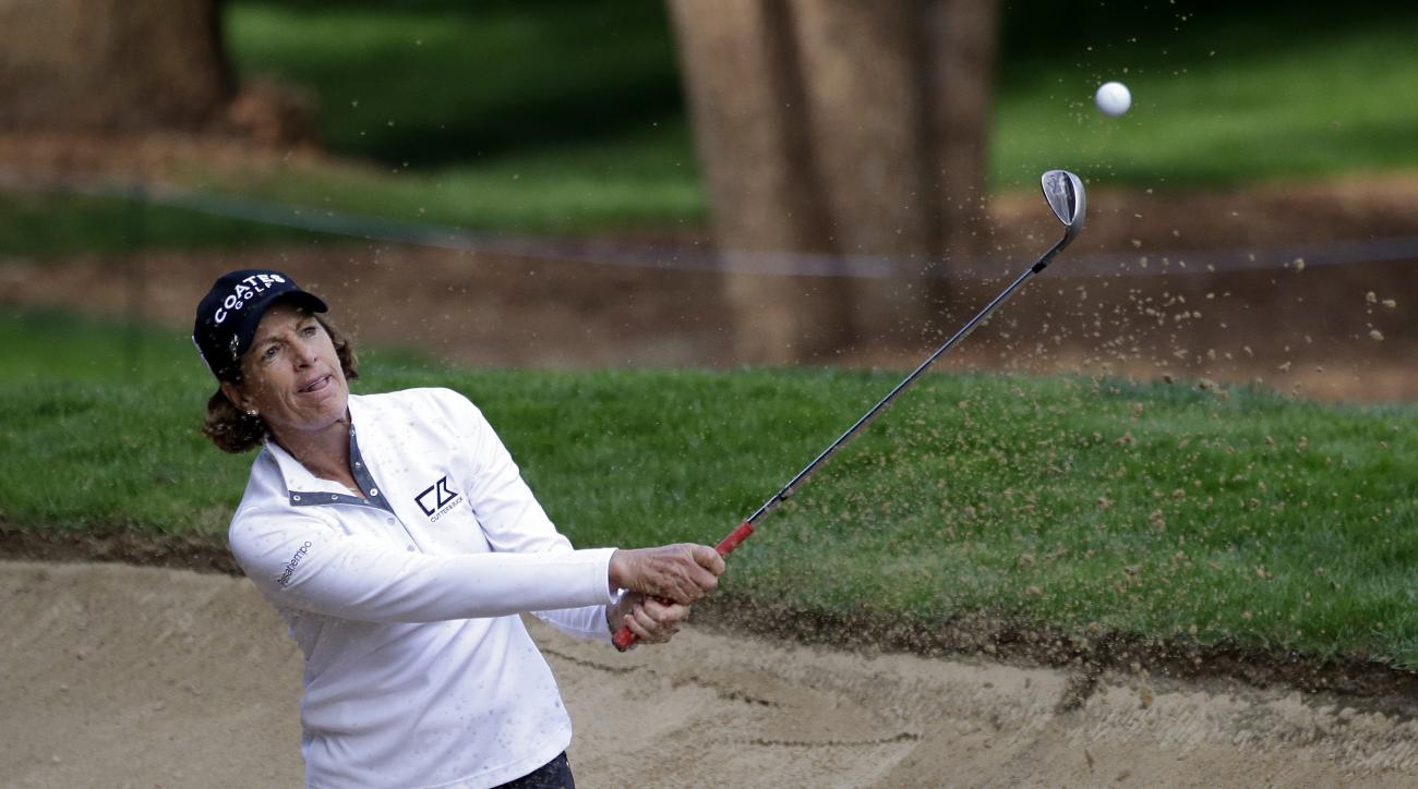Julie Inkster hits out of a bunker during the first round at the Women's PGA Championship golf tournament at Sahalee Country Club on Thursday, June 9, 2016, in Sammamish, Wash. (AP Photo/Elaine Thompson)