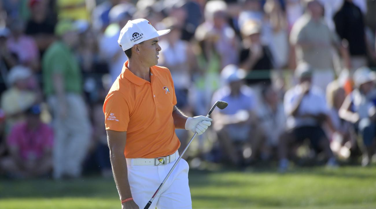 Rickie Fowler watches his shot from the 18th fairway during the final round of the Arnold Palmer Invitational golf tournament in Orlando, Fla., Sunday, March 19, 2017. (AP Photo/Phelan M. Ebenhack)