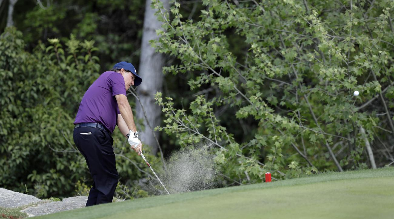 Phil Mickelson hits to the green on the second hole during round-robin play against Si Woo Kim, of South Korea, at the Dell Technologies Match Play golf tournament at Austin County Club, Wednesday, March 22, 2017, in Austin, Texas. (AP Photo/Eric Gay)