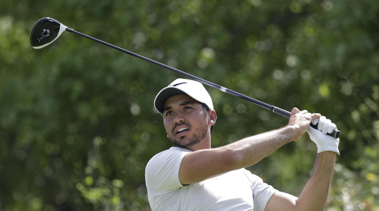 Jason Day, of Australia, watches his tee shot on the sixth hole during round-robin play against Pat Perez at the Dell Technologies Match Play golf tournament at Austin County Club, Wednesday, March 22, 2017, in Austin, Texas. Day conceded the match after