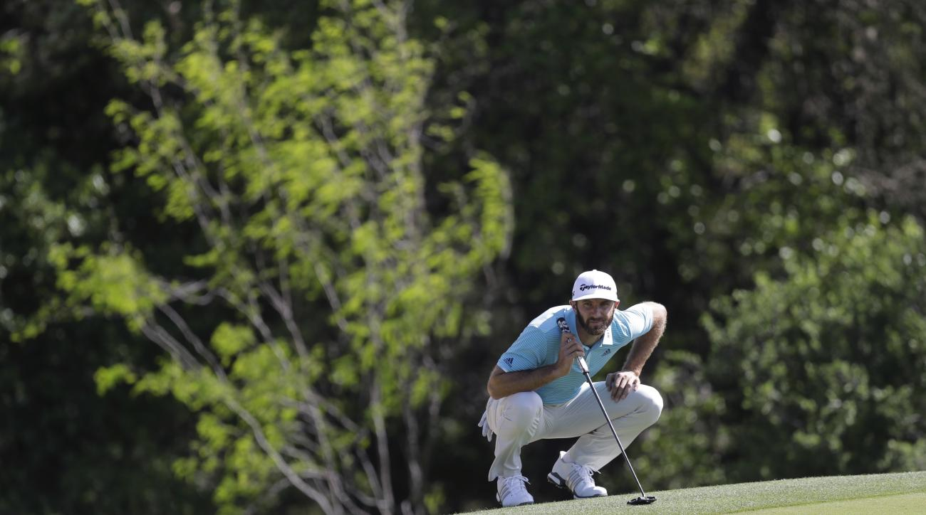 Dustin Johnson lines up his putt on the first hole during round-robin play at the Dell Technologies Match Play golf tournament at Austin County Club, Thursday, March 23, 2017, in Austin, Texas. (AP Photo/Eric Gay)
