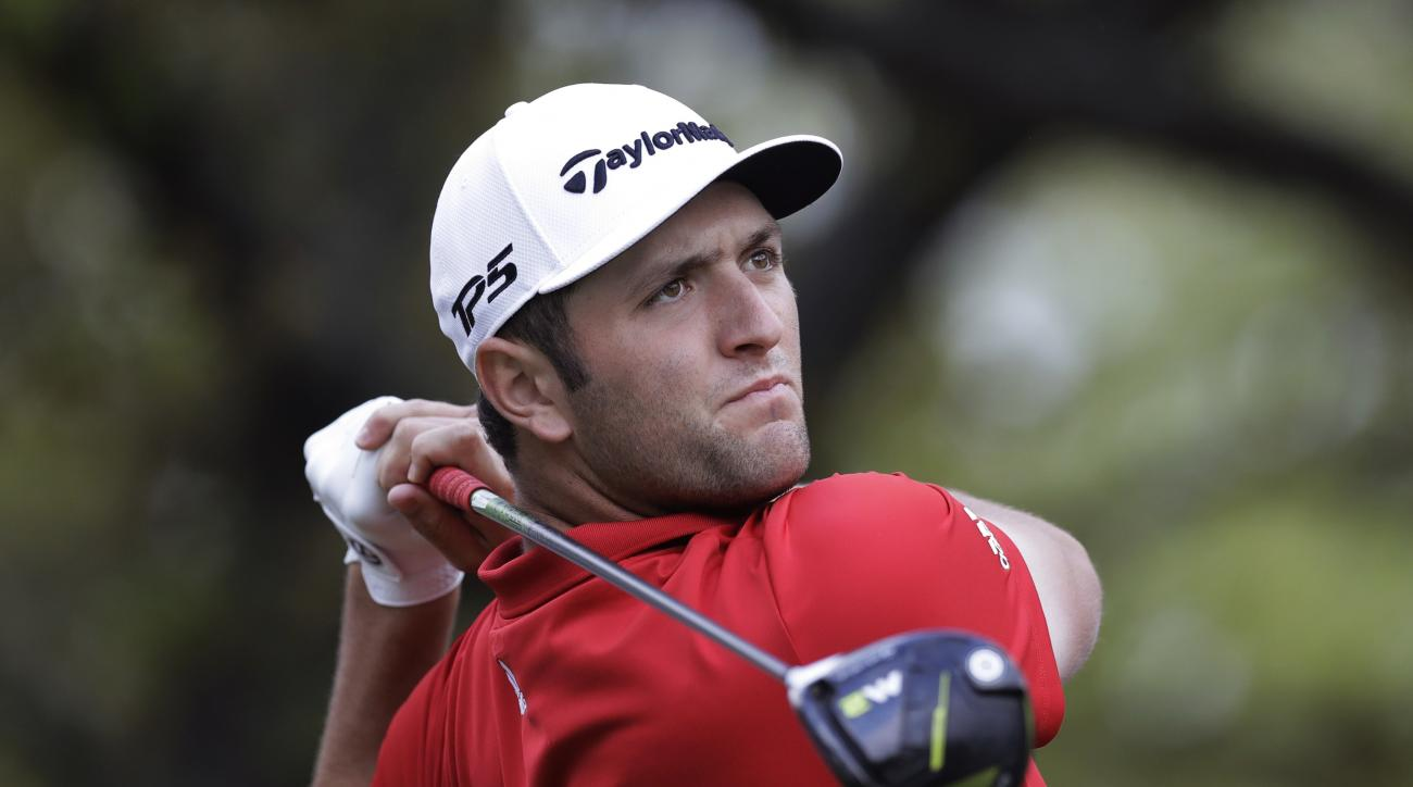 Jon Rahm of Spain watches his drive on the first hole during semifinal play at the Dell Technologies Match Play golf tournament at Austin County Club, Sunday, March 26, 2017, in Austin, Texas. (AP Photo/Eric Gay)